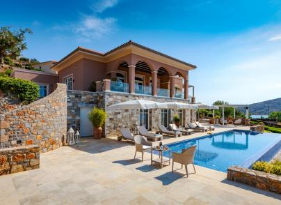 Waterfront villa with pool and garden